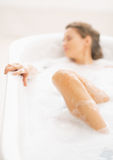 Closeup on young woman laying in bathtub Royalty Free Stock Images