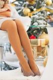 Closeup on young woman legs near christmas tree Stock Photo