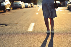 Closeup of young woman legs on the road Stock Photography