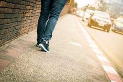 Closeup of young woman legs walk on sidewalk royalty free stock photo