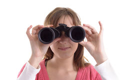 Closeup of young woman looking trough binoculars Stock Images