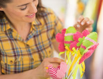 Closeup on young woman making easter decoration Royalty Free Stock Images