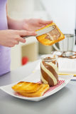 Closeup on young woman making toast with chocolate cream Stock Images