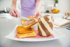 Closeup on young woman making toast with chocolate cream Stock Photo