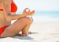 Closeup on young woman meditating on beach Royalty Free Stock Photos