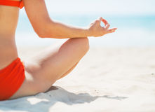 Closeup on young woman meditating on beach Royalty Free Stock Photo