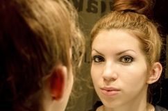 Young woman in the mirror Stock Photography