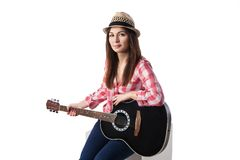 Closeup of young woman musician with guitar. Stock Image