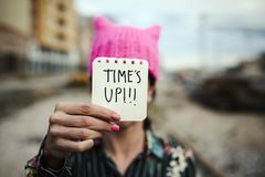 Woman with a pink hat and the text time is up royalty free stock image