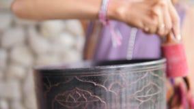 CloseUp: Young Woman Playing on Traditional Tibetan Bronze Singing Bowl. Yoga Meditation Zen Practice with Calm Sounds