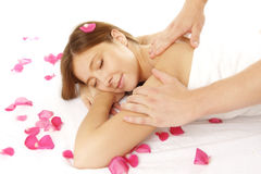 Closeup of young woman receiving massage. Closeup of young woman receiving back massage Royalty Free Stock Photography