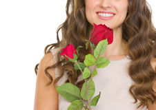 Closeup on young woman with red rose. Isolated on white Stock Images
