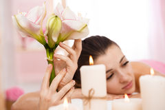 Closeup of young woman relaxing after back massage admiring atmosphere Stock Photos