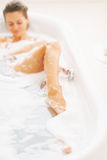 Closeup on young woman relaxing in bathtub royalty free stock photography
