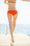 Closeup on young woman running on bridge Royalty Free Stock Photo