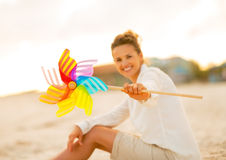 Closeup on young woman showing colorful windmill Stock Image