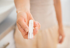 Closeup on young woman showing pregnancy test Stock Photography