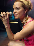 Closeup Of Young Woman Singing Into Microphone Royalty Free Stock Photography