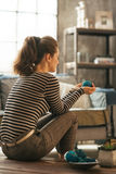 Closeup on young woman sitting in loft apartment Stock Photography