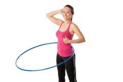 Closeup of young woman standing with hula hoop up Stock Photos