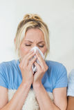 Closeup of a young woman suffering from cold stock images
