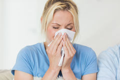 Closeup of a young woman suffering from cold Royalty Free Stock Photography