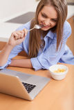 Closeup of young woman surfing internet. Royalty Free Stock Photos