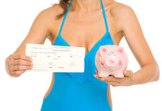 Closeup on woman in swimsuit showing air tickets Stock Photo