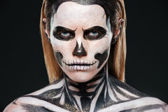 Closeup of young woman with terrifying skeleton makeup stock images