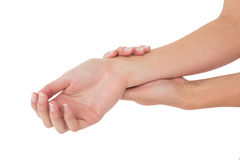 Closeup of a young woman touching her wrist Royalty Free Stock Photos