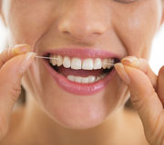 Closeup on young woman using dental floss. In bathroom royalty free stock photography