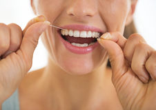 Closeup on young woman using dental floss. In bathroom royalty free stock photos