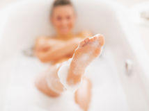 Closeup on young woman washing in bathtub Royalty Free Stock Image