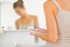 Closeup on young woman washing hands in bathroom Royalty Free Stock Photos