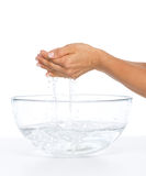 Closeup on young woman washing hands in glass bowl with water Stock Photo