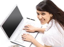 Closeup.young woman working on laptop. the view from the top. Isolated on white background Stock Photos