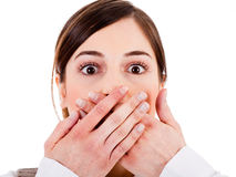 Closeup of young women covering her mouth Royalty Free Stock Photo