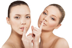 Women making a hush gesture Royalty Free Stock Photography