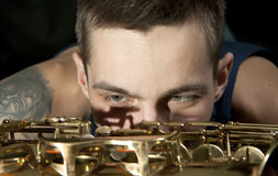 Closeup youngman look on saxophone Stock Photo