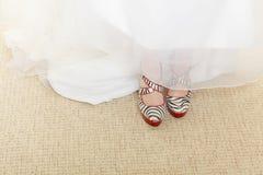 Closeup of zebra pattern shoes and wedding dress Stock Image