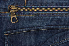 Closeup of zipper in blue jeans Stock Photos