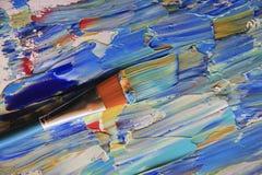 Closeupbakgrund av borsten och paletten Arkivfoton