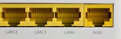 Closeupbaksida av wifirouterLAN och GLÅMIGA portar Royaltyfri Fotografi