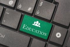 Closeupbild av utbildningsknappen av tangentbordet av en modern dator fotografering för bildbyråer