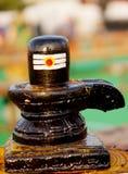 Closeupen av den Shiv lingaen som snidas stenar statyn, symbolet av den hinduiska guden Shiva royaltyfria bilder