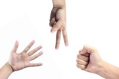 Closeupen av händer som gör tecknet att spela, vaggar, skyler över brister, sax Arkivfoto