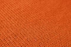 Closeupen av kulör Alpaca för djup orange färg stack ulltyg i diagonala modeller arkivbild