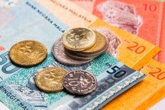 Closeupen av Malaysia Ringgitvaluta noterar och mynt arkivbilder