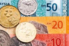 Closeupen av Malaysia Ringgitvaluta noterar och mynt Arkivfoto