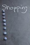 Att shoppa listar bakgrund Arkivbilder